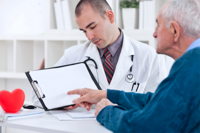 senior man consulting with doctor